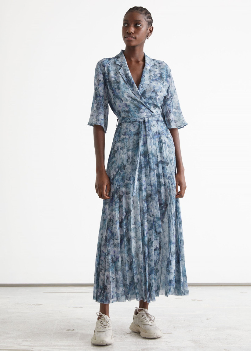 Vintage-inspired double-breasted blue floral summer wedding guest dress
