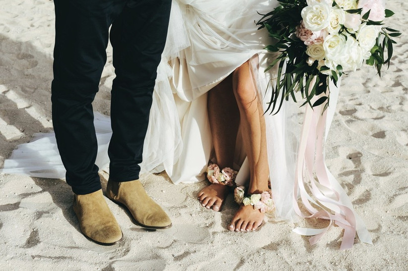 bride wearing floral anklets for hawaii beach wedding