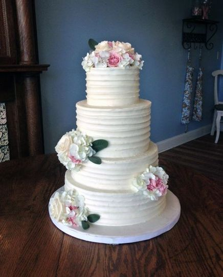 A rustic buttercream cake with fresh florals.