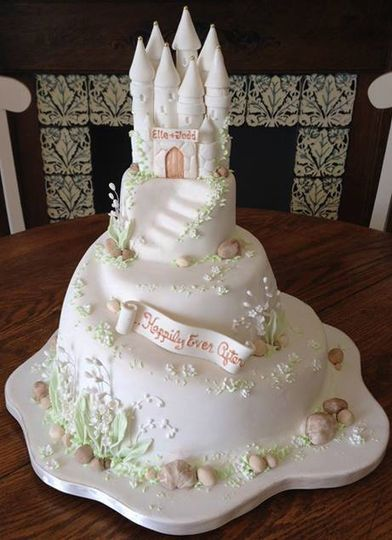 A sculpted castle cake with lily of the valley accents.