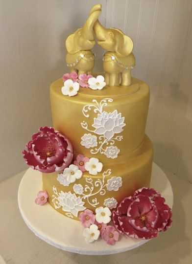 Sugar peonies and hand piped lotus flowers adorned this Thai inspired cake with sculpted sugar...