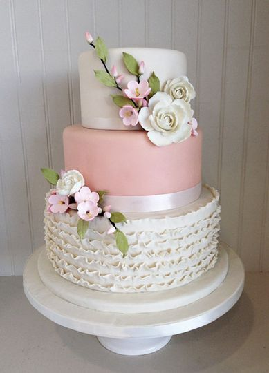 A fondant cake with beautiful apple blossoms and sugar ruffles for a spring wedding.