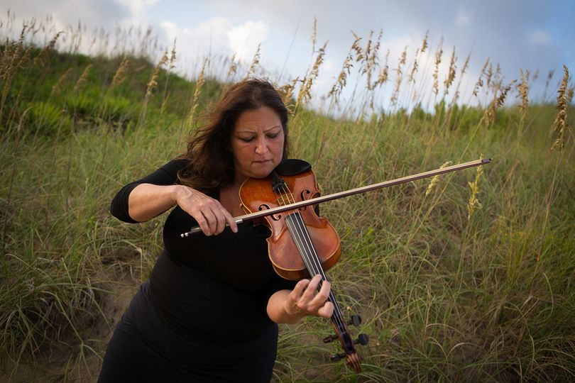Violin playing in the meadows