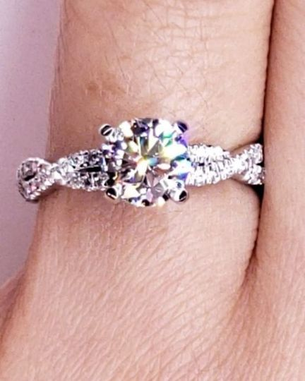Love knot with round center stone