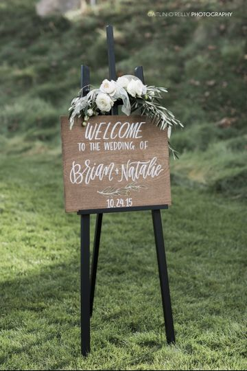 Custom ceremony welcome sign, done on a custom stained piece of alder wood, with hand lettering done...