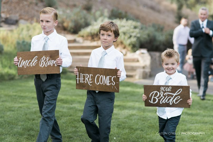 Custom stained, alder wood signs with hand lettering done in white ink, with a sweet sentiment for...