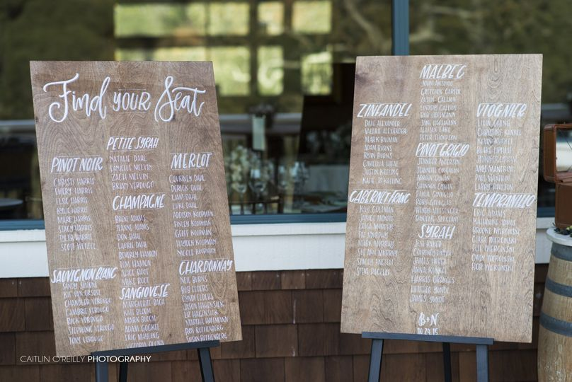 Two extra large, custom seating charts were created on custom stained alder wood, with hand...
