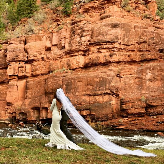 Bride walking along the river