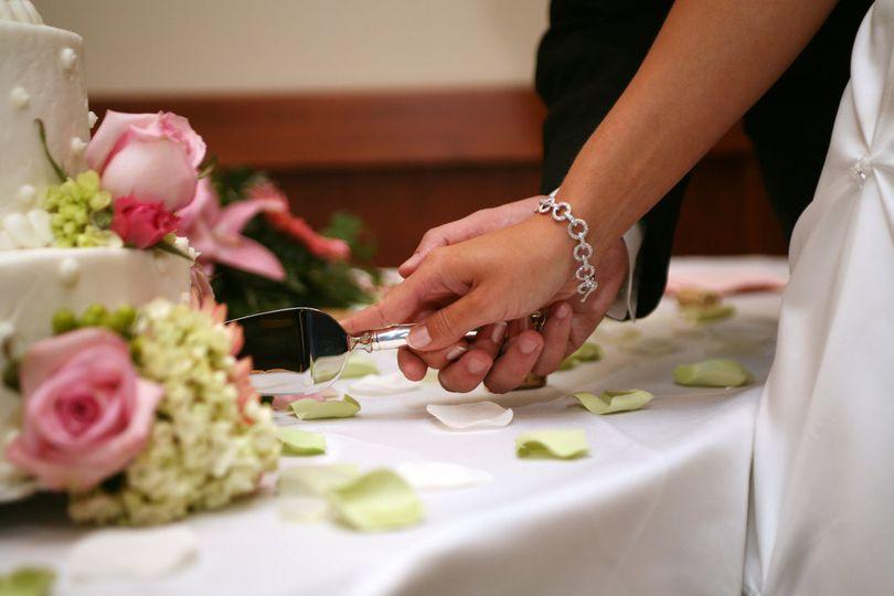 Bride & Groom Cutting Cake