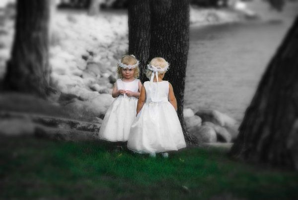 Bride's daughter and groom's daughter. One cooperated, one would not, but the picture turned out...