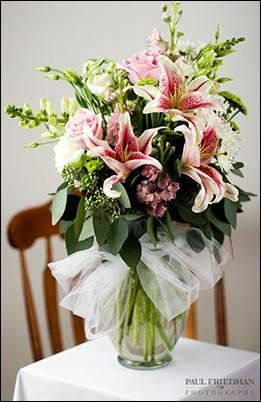 Large display arrangement with Stargazer Lilies.