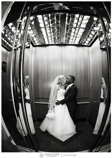black and white bride and groom elevator