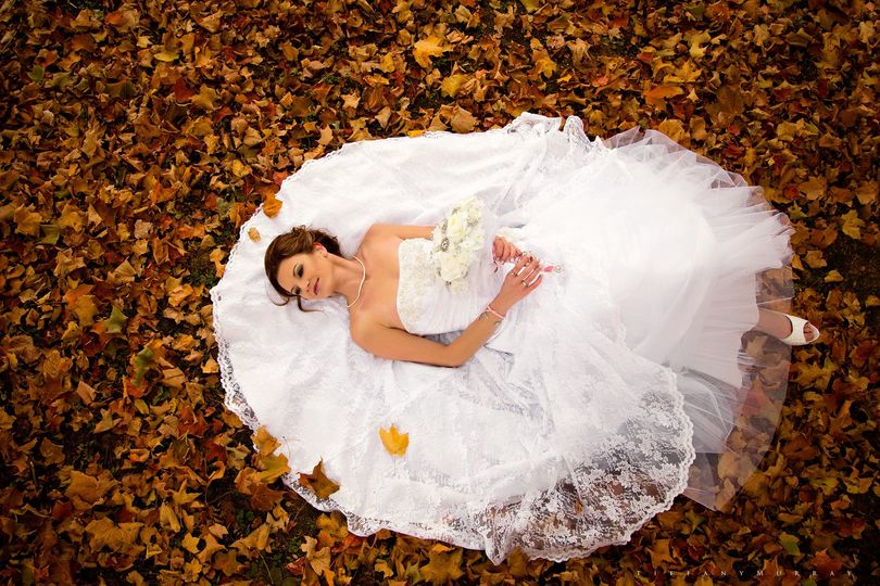 bride laying in leaves waters edge ashland ohio we