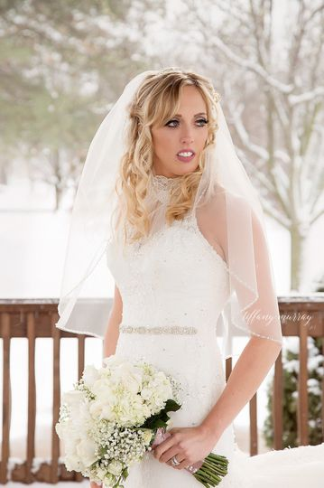 stunning bride on snowy day photographer tiffany m