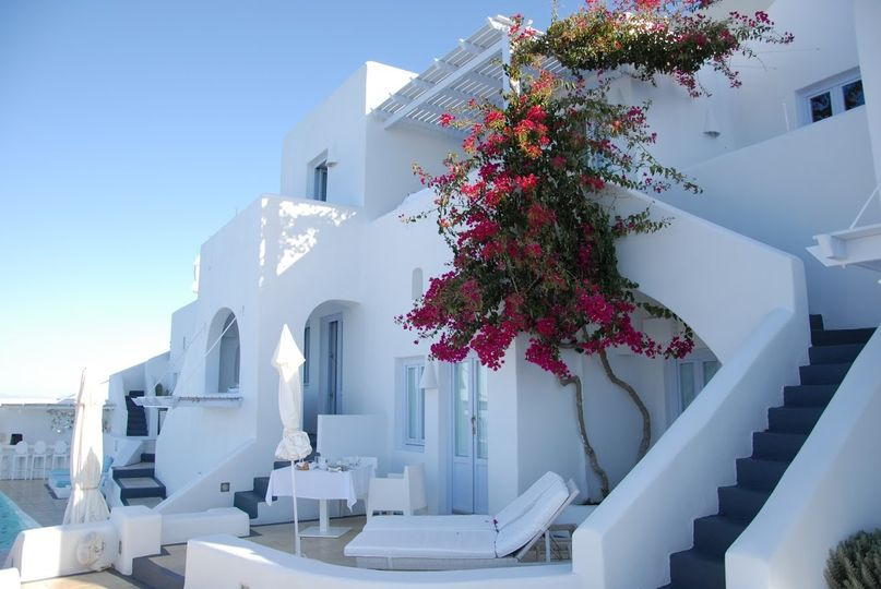 Santorini's white-washed walls, Bougainville and sunshine.  Image:  Errica Diaz