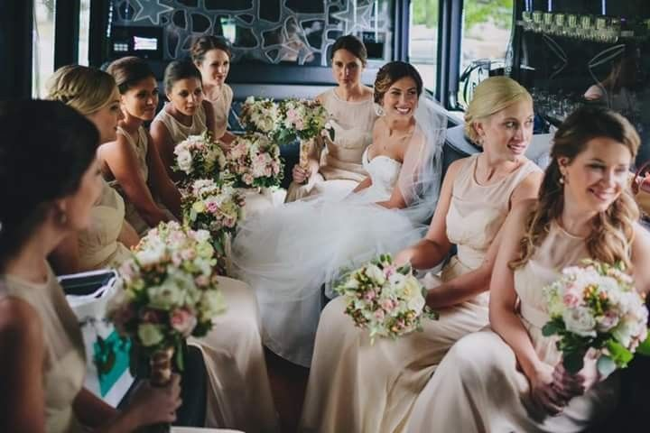 Bride and bridesmaids with their bouquets in hand