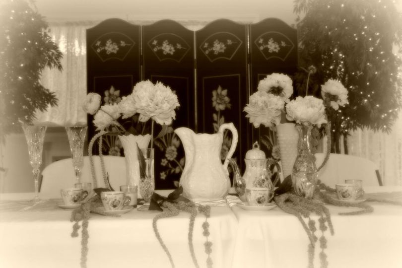 Head table tablescape for a romantic, vintage wedding reception including peonies, an heirloom tea...