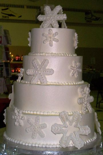 A snow flake themed cake created for a Winter wedding.