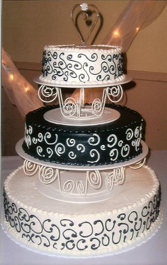 A black and white elegant but simple wedding cake for a winter wedding.