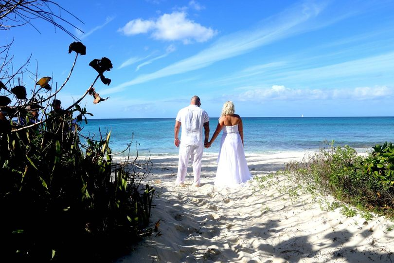 Couple looking out at Nuptial Beach Nassau Bahamas just after their beach wedding ceremony