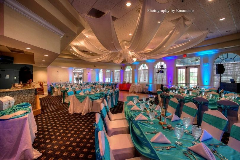 Reception tables and turquoise decor
