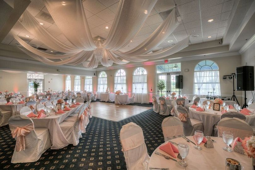 Reception tables with coral decor
