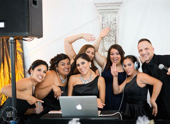 AMOSPRO DJ Kevin Duncan posing for a picture with the wedding party.