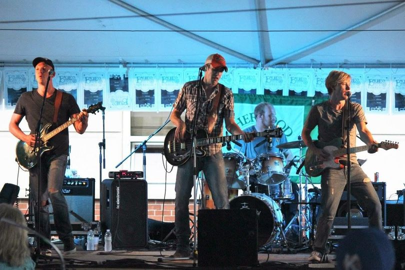 Big Time Grain Co. performing onstage