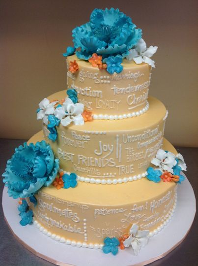 3-tier cake with blue flowers
