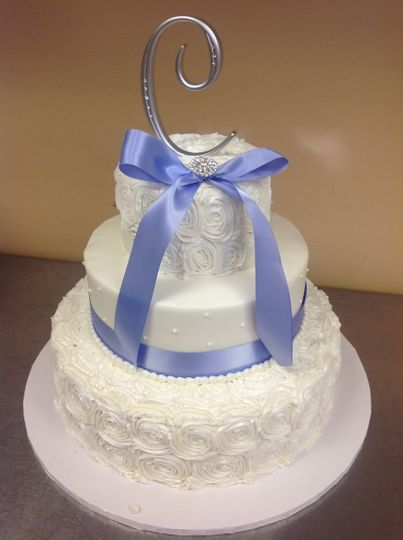 Wedding cake with a periwinkle ribbon