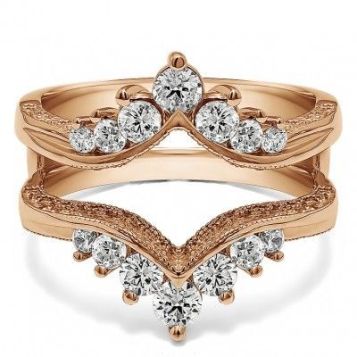 Pointed gold band with studs