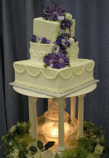 Purple flower cascade wedding cake