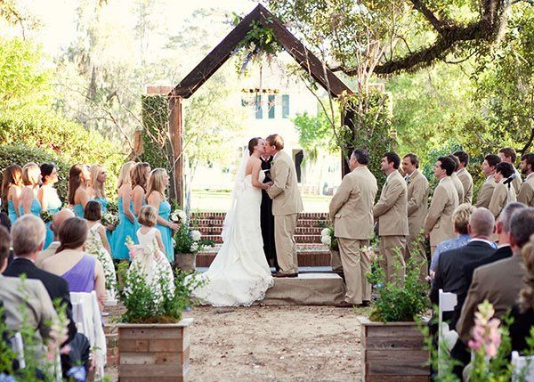 Stable courtyard wedding ceremony | Photo by Abby Mims