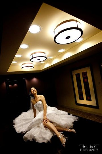 The bride was preparing in this bridal suite at a hotel, we saw the big table and the lights are...