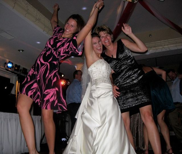 Bride with guest dancing