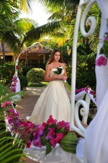 Audra walking down the aisle to her groom at the Melia Caribe Tropical in Punta Cana, Dominican...