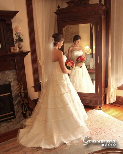 Bride reflecting in French armoire mirror in honeymoon suite. One of St. Louis' most romantic...