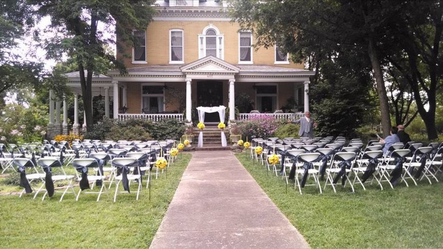 Wedding white chairs on the front lawn