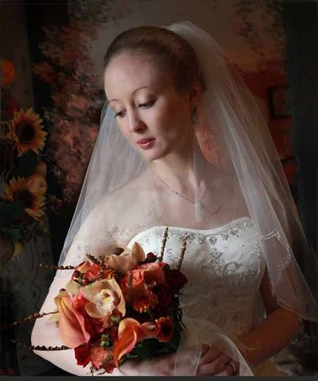 Rembrandt lighting and natural light create a timeless bridal portrait.