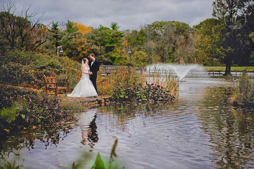 bride and groom by the river