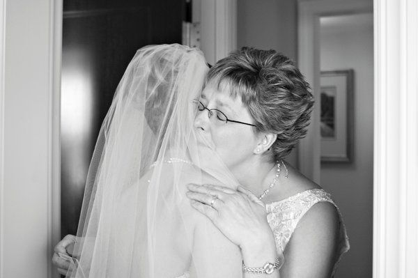 Mother of the Bride sees her daughter in her dress for the first time.