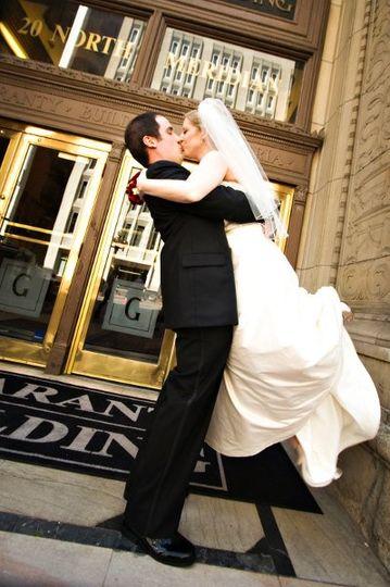 Exuberant groom lifts his bride!