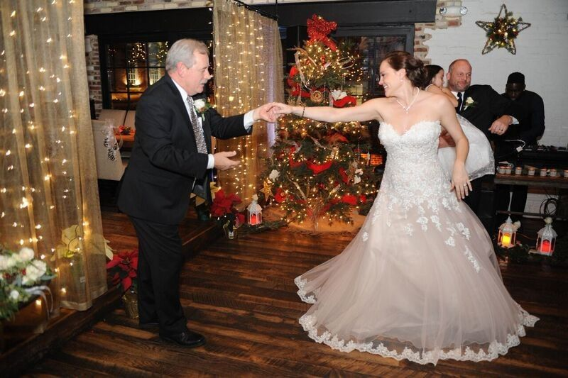 Bride and guest dancing