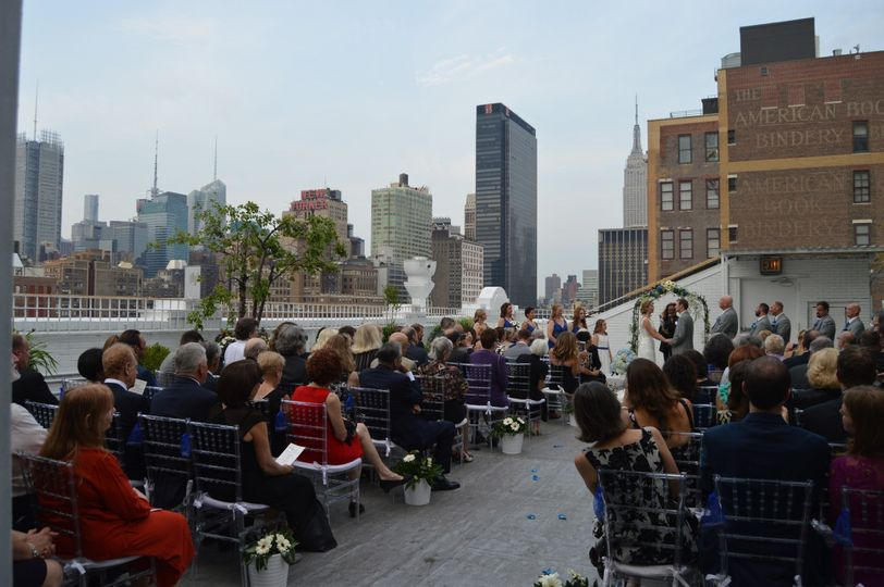 Our couple exchanging their vows on the roof of Studio 450 in Manhattan, NY.  The New Yorker Hotel...