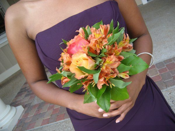 The bridesmaid's bouquets were orange roses, orange alstroemerlia, cherry brandy roses, and tropical...