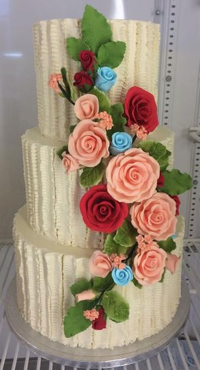 Beige cake with pink and red ascending roses