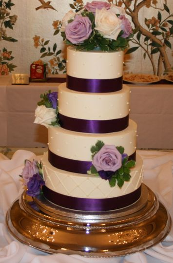 White cake with purple ribbons