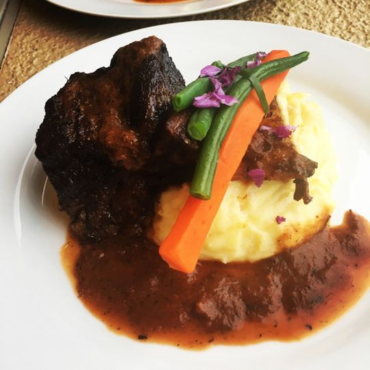 Braised beef short ribs over yukon garlic smashed potatoes