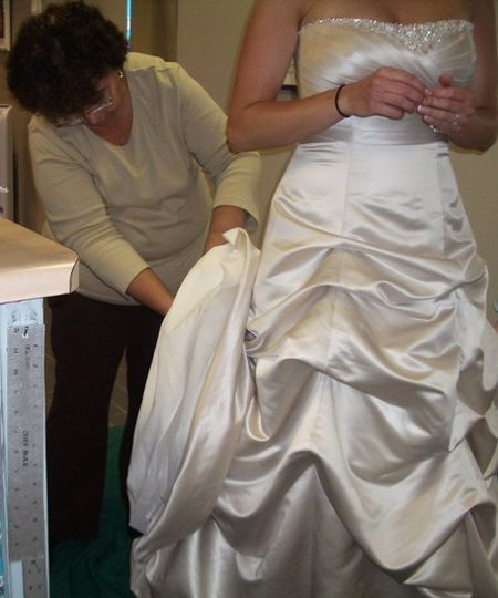 seamstressworkingonweddinggown