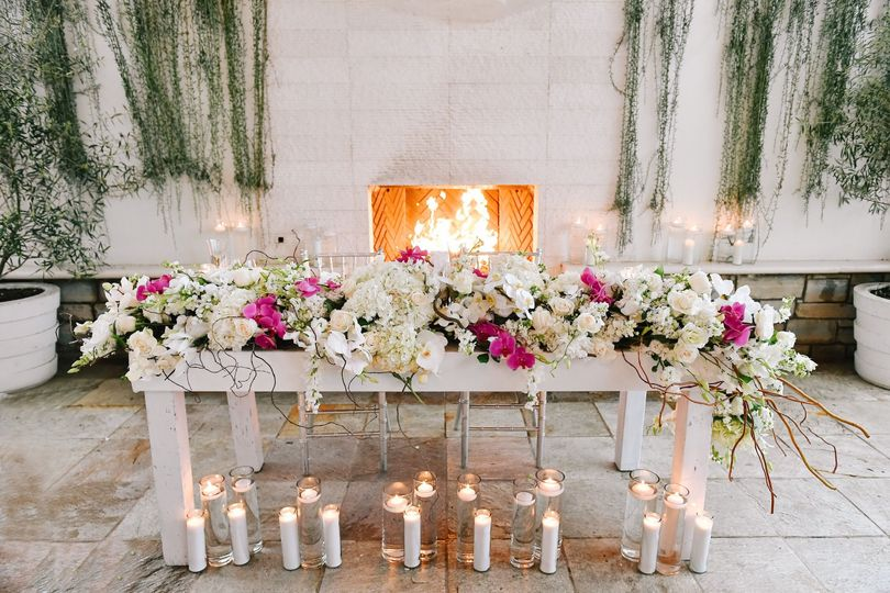 Pink and white sweetheart table at monarch beach resort wedding